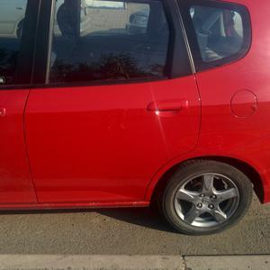 После ремонта. Была вмятина на задней двери, вмятина между дверью и колесом, шоркнут бампер.