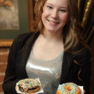 На фото моя сестра - ее первая сделанная партия пончиков, надписей не видно, но их много уместилось)